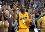 Los Angeles Lakers guard Kobe Bryant watches the clock run down the final seconds of Game 5 of their Western Conference semifinal against the San Antonio Spurs in Los Angeles, May 14, 2002. Bryant, the 18-time NBA All-Star who won five championships and became one of the greatest basketball players of his generation during a 20-year career with the Los Angeles Lakers, died in a helicopter crash Sunday, Jan. 26, 2020. He was 41. (AP Photo/Kevork Djansezian)