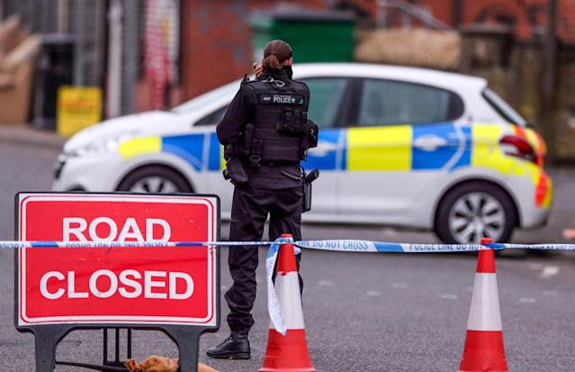 An armed police officer at the scene on King Street, Blackburn, following the fatal shooting of Aya Hachem on Sunday. (PA)