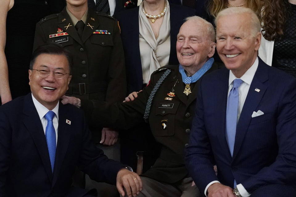 President Joe Biden, retired U.S. Army Col. Ralph Puckett and South Korean President Moon Jae-in, pose for a photo after Puckett was presented the Medal of Honor in the East Room of the White House, Friday, May 21, 2021, in Washington. (AP Photo/Alex Brandon)