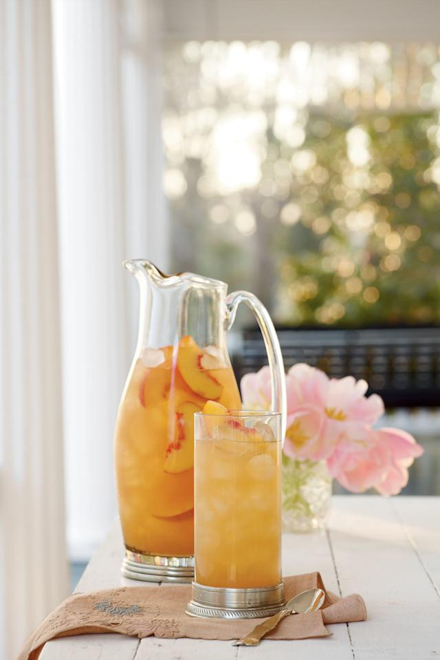 """<p><strong>Recipe:</strong> <strong><a href=""""http://www.myrecipes.com/recipe/governors-mansion-peach-punch-50400000112157/"""" target=""""_blank"""">Governor's Mansion Summer Peach Tea Punch</a></strong></p> <p> Tea, peach nectar, ginger ale, lemonade, and club soda all come together to create this refreshing summer drink that is absolutely perfect for a hot Southern day. This recipe makes about a gallon, but you can double it as you need to depending on the size of your gathering. What's so great about this Governor's Mansion Summer Peach Tea Punch is that it brings together so many of the great tastes of the South, including peaches and tea—and what could be more Southern than those? Grab a tall glass, fill it with ice, and get ready to garnish it with fresh peach slices for a pretty finish.</p>"""