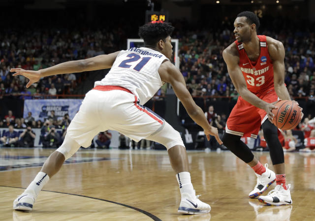 Ohio State forward Keita Bates-Diop, right, looks to pass around the defense of Gonzaga forward Rui Hachimura (21) during the first half of a second-round game in the NCAA men's college basketball tournament Saturday, March 17, 2018, in Boise, Idaho. (AP Photo/Otto Kitsinger)
