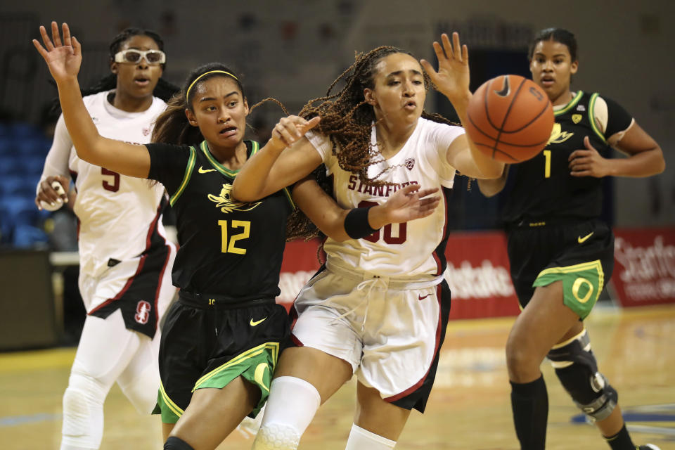 Stanford guard Haley Jones and Oregon guard Te-Hina Paopao battle for a rebound during the first half of an NCAA college basketball game in Santa Cruz, Calif., Friday, Jan. 8, 2021. (AP Photo/Jed Jacobsohn)
