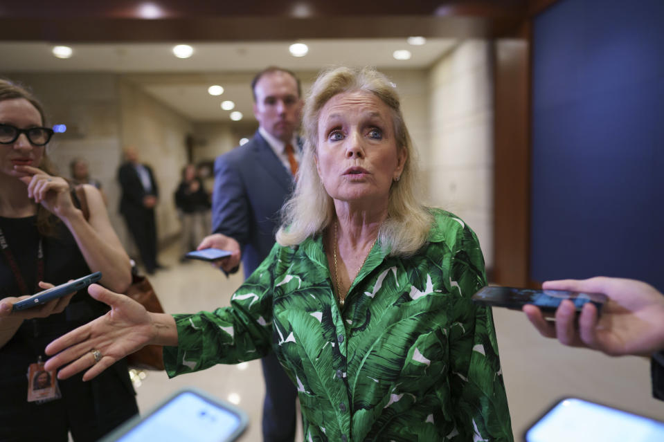 Rep. Debbie Dingell, D-Mich., a staunch defender of the American automobile industry, pauses for reporters after a meeting of the House Democratic Caucus and Biden administration officials to discuss progress on an infrastructure bill, at the Capitol in Washington, Tuesday, June 15, 2021. (AP Photo/J. Scott Applewhite)