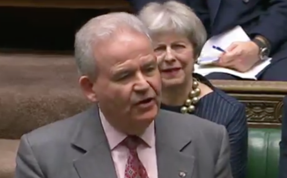 Theresa May could be seen pulling a face behind Julian Lewis.