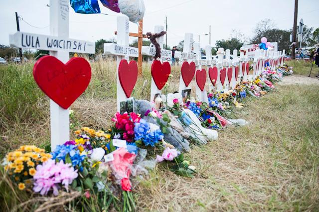 A memorial draws tributes to the victims of the mass shooting at First Baptist Church in Sutherland Springs, Texas, on Friday.