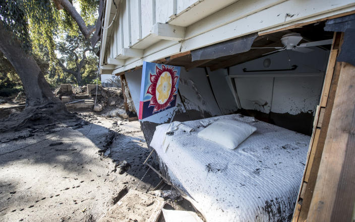 <p>Flood waters and mud pushed out the wall of a bedroom where a woman was reported missing by friends and family but was later found to be safe on Jan. 11, 2018 in Montecito, Calif. (Photo: Brian van der Brug/Los Angeles Times via Getty Images) </p>