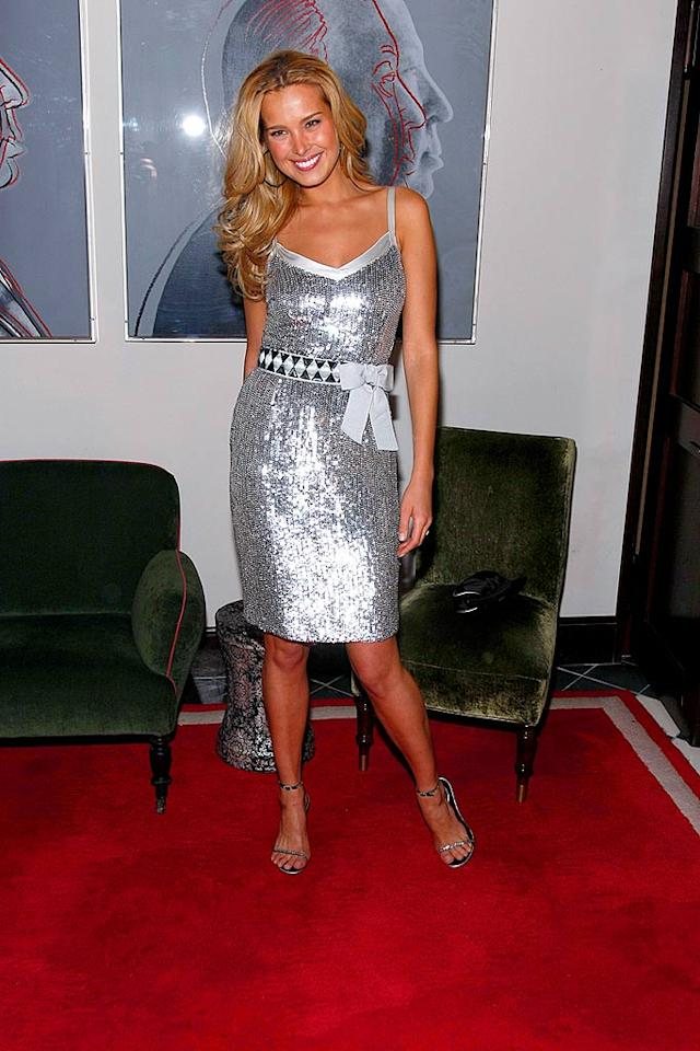 "Petra Nemcova shines from head to toe in her silver ensemble. The Czech supermodel adds a dash of whimsy to her fabulous frock with a belted bow. Jemal Countess/<a href=""http://www.wireimage.com"" target=""new"">WireImage.com</a> - December 4, 2007"