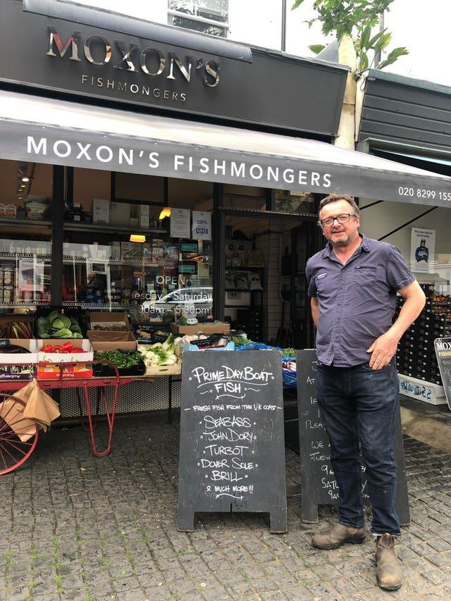 Robin Moxon with one of his 'prime day boat' signs
