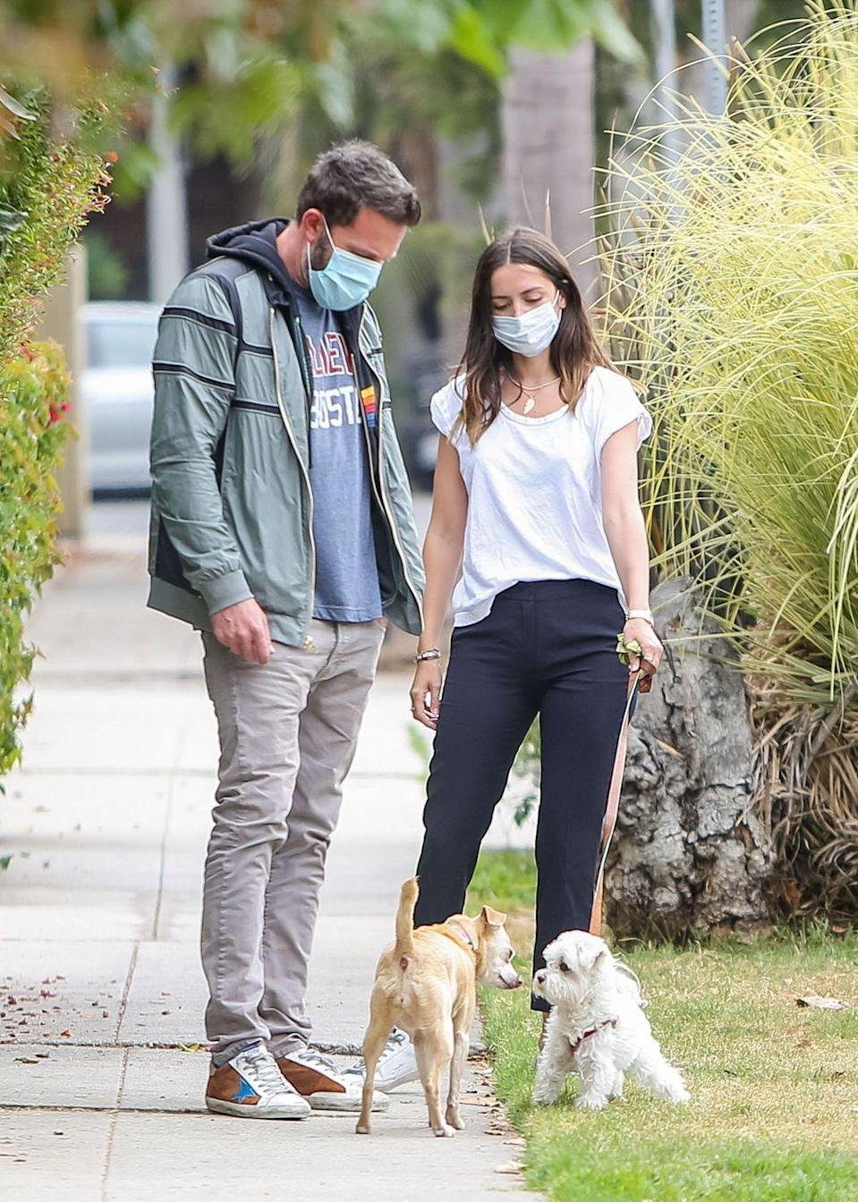 """<p>No quarantine couple has thrived off PR quite like Ben Affleck's and Ana de Armas' relationship. The couple met on the set of their upcoming film <em>Deep Water</em>. After a getaway to Cuba in March, the pair <a href=""""https://www.usmagazine.com/celebrity-news/pictures/ben-affleck-and-ana-de-armas-relationship-timeline/march-13-2020/"""" rel=""""nofollow noopener"""" target=""""_blank"""" data-ylk=""""slk:started quarantining together"""" class=""""link rapid-noclick-resp"""">started quarantining together</a>—except they've been seen out together nearly once a day. The couple takes their dogs for a walk every day with Dunkin' Donuts coffee in hand. </p><p>Ana de Armas even <a href=""""https://www.thecut.com/2020/04/ana-de-armas-blocks-fan-account-on-twitter.html"""" rel=""""nofollow noopener"""" target=""""_blank"""" data-ylk=""""slk:blocked a fan Twitter account"""" class=""""link rapid-noclick-resp"""">blocked a fan Twitter account</a> that got a little, um, creative with captions to the never-ending supply of photos. Hey, I'll take any drama I can get.</p>"""