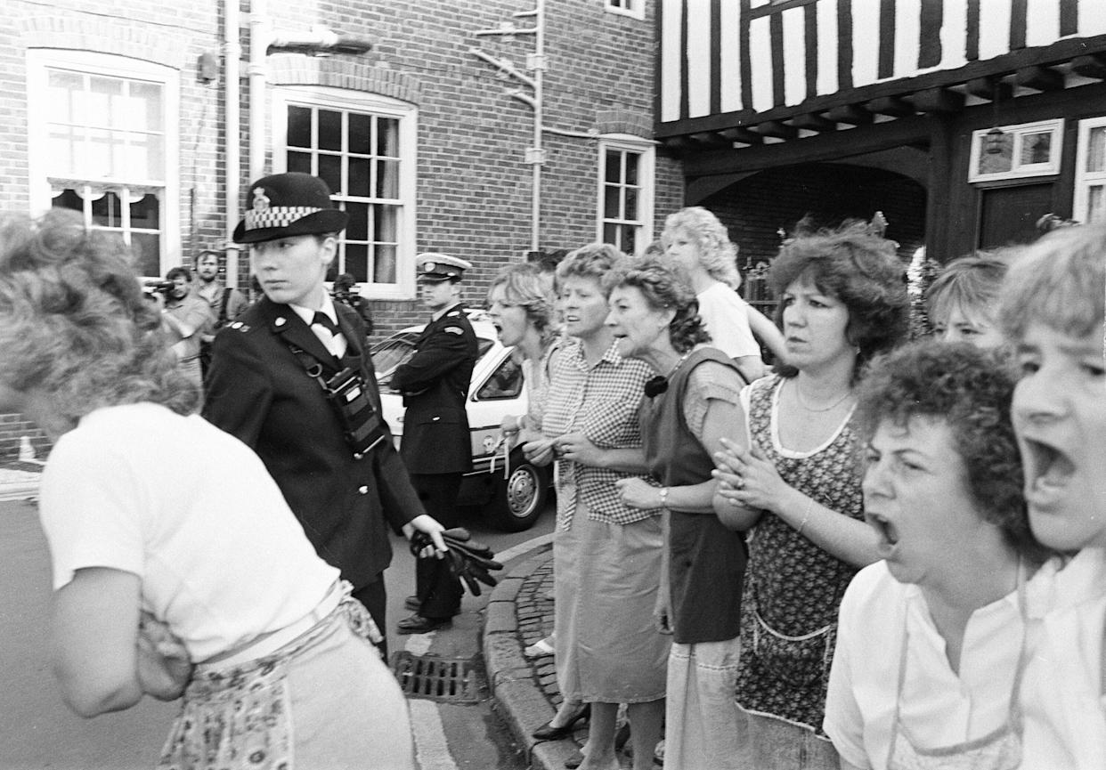 Colin Pitchfork arrives at court, charged with the rape and murder of two Leicestershire schoolgirls, he is greeted by jeers from local factory workers, Leicester Magistrates Court, Monday 21st September 1987.