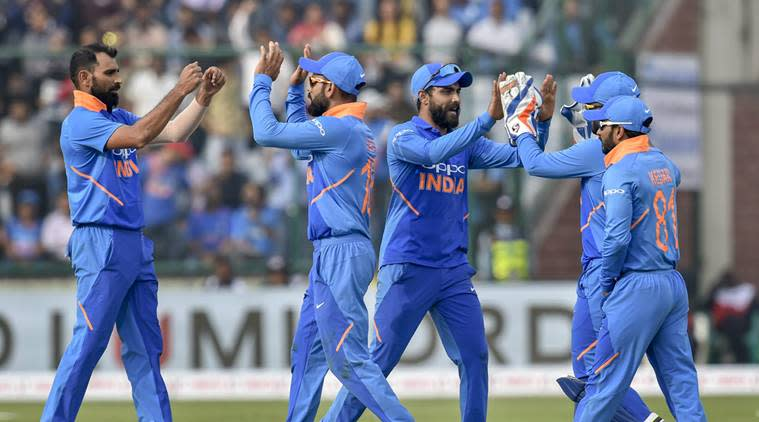 Indian cricket team captain Virat Kohli celebrates with teammates the dismissal of Australian batsman Peter Handscomb during the 5th ODI cricket match, at Feroz Shah Kotla Cricket Stadium in New Delhi