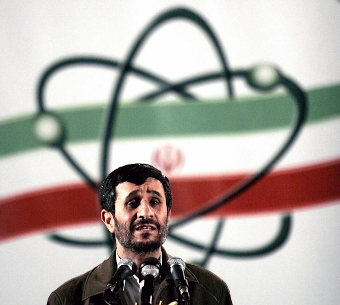 FILE- In this April, 9, 2007, file photo, Iranian President Mahmoud Ahmadinejad speaks at a ceremony in Iran's nuclear enrichment facility in Natanz, south of capital Tehran, Iran. President Barack Obama's reluctance to give military aid to Syrian rebels may be simply explained in part in three words: Iranian nuclear weapons. For the first time in years, the United States has seen a glimmer of hope in persuading Iran to curb its nuclear enrichment program so it cannot quickly or easily make an atomic bomb. But Tehran is unlikely to bend to Washington's will on its nuclear program if it is battling American-supplied rebels at the same time in Syria, where Iranian forces are believed to be fighting alongside the Assad regime's army. (AP Photo/Hasan Sarbakhshian, File)