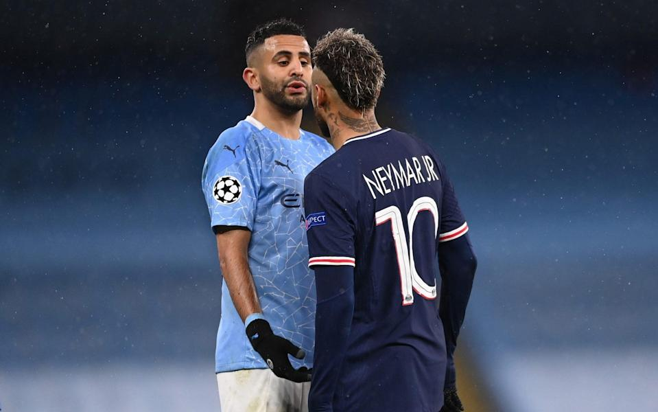 Riyad Mahrez of Manchester City clashes with Neymar of Paris Saint-Germain during the UEFA Champions League Semi Final Second Leg match between Manchester City and Paris Saint-Germain at Etihad Stadium on May 04, 2021 in Manchester, England. - GETTY IMAGES