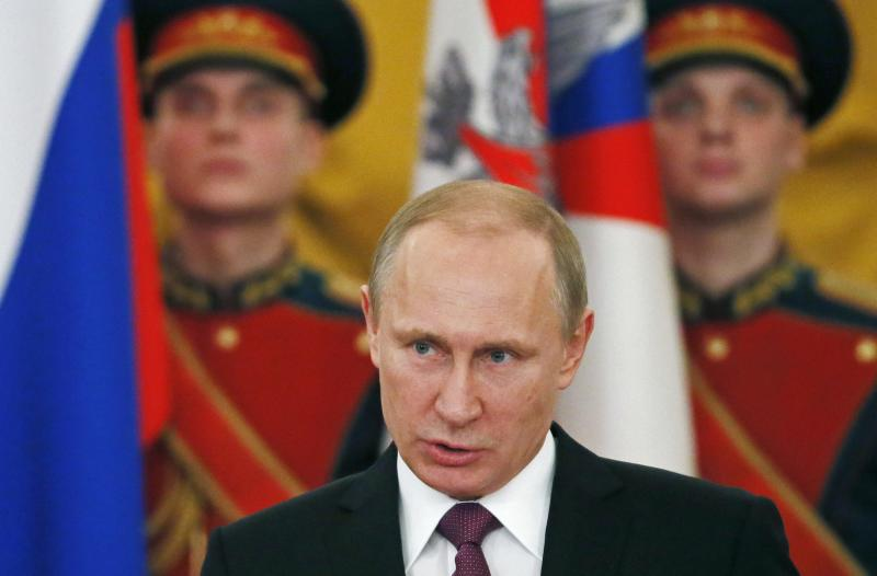 Russia's President Vladimir Putin attends a ceremony to award World War Two veterans at the Kremlin in Moscow