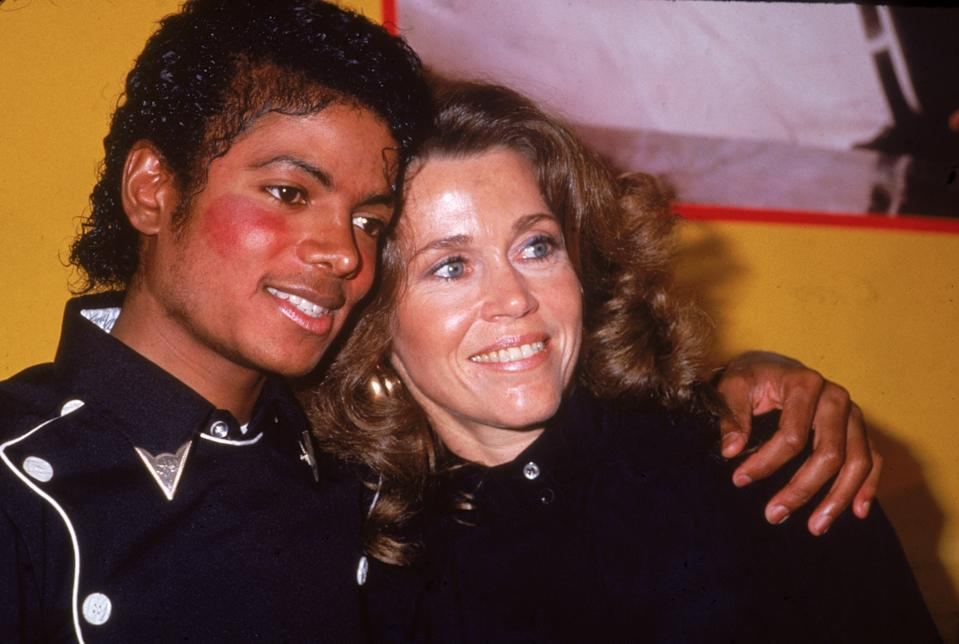 American pop singer Michael Jackson and American actress Jane Fonda celebrate his album 'Thriller' and her workout album going gold, February 1983. (Photo by Frank Edwards/Pictorial Parade/Getty Images)