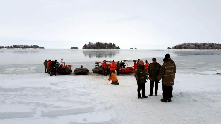This image released by the Surete du Quebec shows rescue personnel at Lake Saint-Jean in the Canadian province on January 25, 2020, as they prepared to resume  recovery operations for French snowmobilers whose machines fell through thin ice