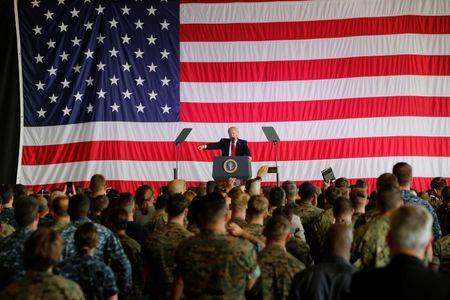 U.S. President Donald Trump delivers remarks to U.S. military personnel at Naval Air Station Sigonella following the G7 Summit, in Sigonella