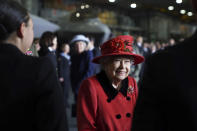 Britain's Queen Elizabeth II smiles during a visit to HMS Queen Elizabeth at HM Naval Base, ahead of the ship's maiden deployment, in Portsmouth, England, Saturday May 22, 2021. HMS Queen Elizabeth will be leading a 28-week deployment to the Far East that Prime Minister Boris Johnson has insisted is not confrontational towards China. (Steve Parsons/Pool Photo via AP)