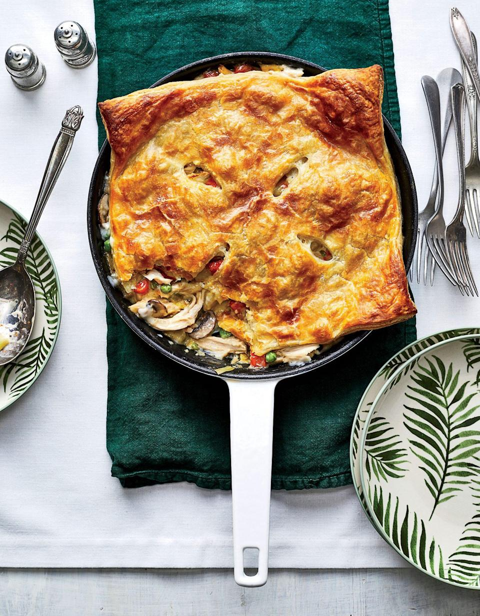 "<p><strong>Recipe: </strong><a href=""https://www.southernliving.com/recipes/skillet-chicken-pot-pie-leeks-mushrooms-recipe"" rel=""nofollow noopener"" target=""_blank"" data-ylk=""slk:Skillet Chicken Pot Pie with Leeks and Mushrooms"" class=""link rapid-noclick-resp""><strong>Skillet Chicken Pot Pie with Leeks and Mushrooms</strong></a></p> <p>Our cooking group knows: Everything tastes better when it comes from the cast-iron skillet. This recipe uses up that puff pastry that's been sitting in your freezer, too. ""This one is definitely a keeper!"" said one reader.</p>"