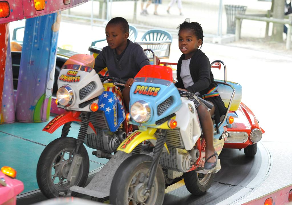 """The youngest of Madonna's brood, David, 4, and Mercy, 5, took a spin on the kiddie rides. A/<a href=""""http://www.x17online.com"""" target=""""new"""">X17 Online</a> - August 1, 2010"""