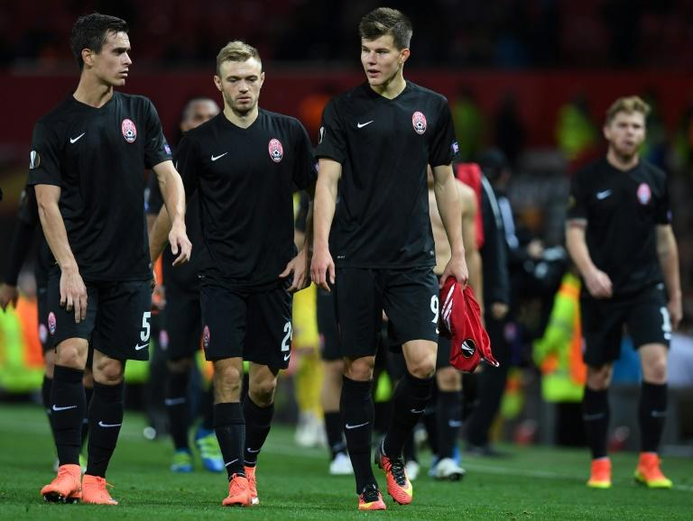 Zorya Luhansk players leave the pitch following their UEFA Europa League Group A match against Manchester United, at Old Trafford in Manchester, on September 29, 2016