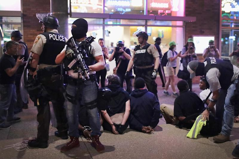 Police arrest demonstrators in St. Louis who were protesting the acquittal of a police officer involved in a fatal shooting