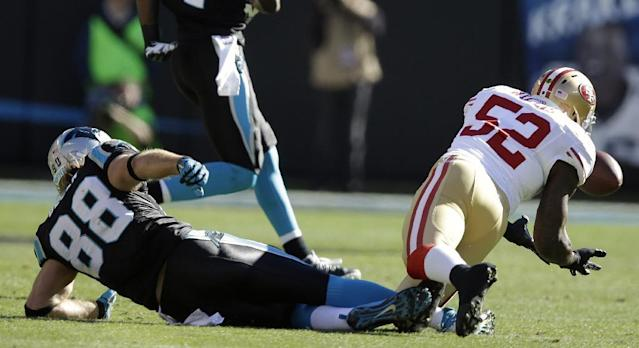 San Francisco 49ers inside linebacker Patrick Willis (52) picks off Carolina Panthers quarterback Cam Newton foe an interception during the first half of a divisional playoff NFL football game, Sunday, Jan. 12, 2014, in Charlotte, N.C. (AP Photo/Gerry Broome)