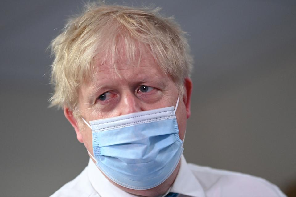 Britain's Prime Minister Boris Johnson visits Colchester hospital in Colchester, eastern England on May 27, 2021. - Britain's government