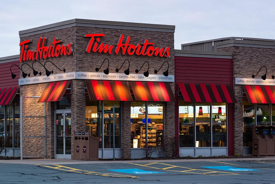 Bedford, Canada - April 11, 2020 - Tim Hortons restaurant in the Larry Uteck shopping area. The restaurant chain is only offering drive thru service at all locations during the ongoing COVID-19 pandemic.