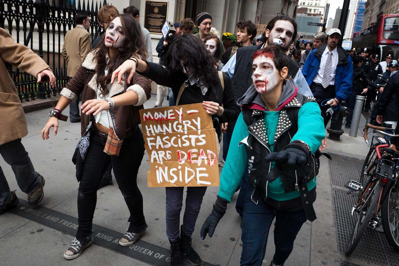 Protesters from Occupy Wall Street march through the financial district dressed as corporate zombies Monday, Oct. 3, 2011, in New York. The protests have gathered momentum and gained participants in recent days as news of mass arrests and a coordinated media campaign by the protestors have given rise to similar demonstrations around the country. (AP Photo/John Minchillo)