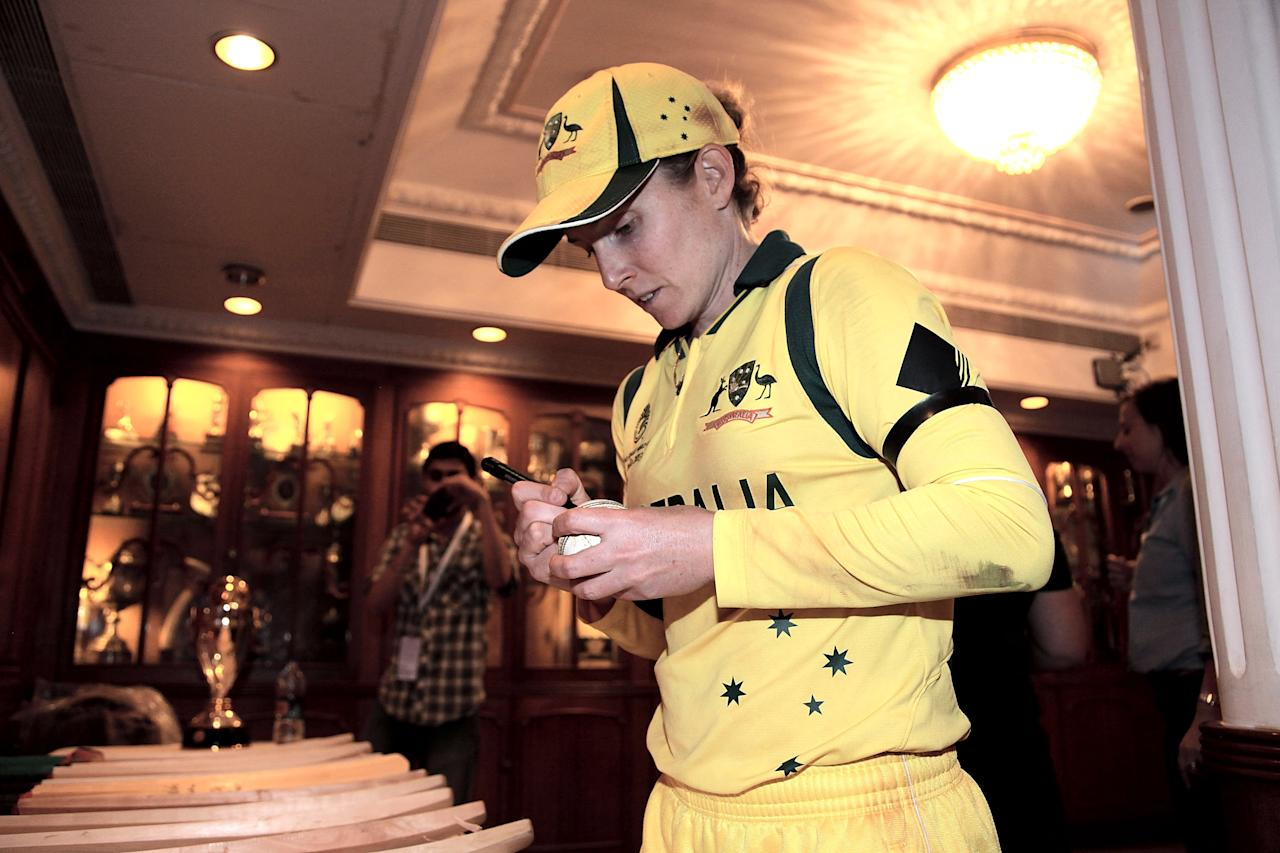 MUMBAI, INDIA - FEBRUARY 17:  Jodie Fields, winning  captain of Australia signing match balls  after the final between Australia and West Indies of the Women's World Cup India 2013 played at the Cricket Club of India ground on February 17, 2013 in Mumbai, India. (Photo by Graham Crouch/ICC via Getty Images)