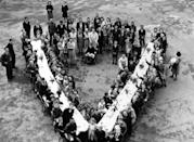 <p>Residents in South London get creative with the table arrangement for their V-E Day celebration. </p>