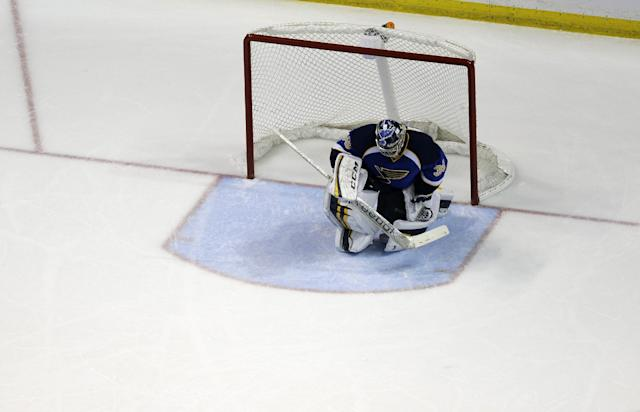 St. Louis Blues goalie Ryan Miller pauses after giving up the game-winning goal to Chicago Blackhawks' Jonathan Toews during overtime in Game 5 of a first-round NHL hockey playoff series Friday, April 25, 2014, in St. Louis. The Blackhawks won 3-2. (AP Photo/Jeff Roberson)