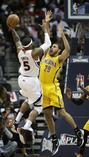 Atlanta Hawks small forward Josh Smith (5) shoots against Indiana Pacers power forward Jeff Pendergraph (29) during the first half of an NBA first-round playoff basketball game in Atlanta, Friday, May 3, 2013. (AP Photo/John Bazemore)