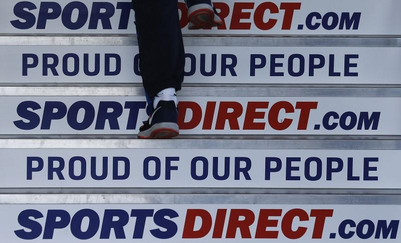 A worker walks up stairs before a Sports Direct general meeting to vote on the re-appointment of chairman Keith Hellawell in Shirebrook