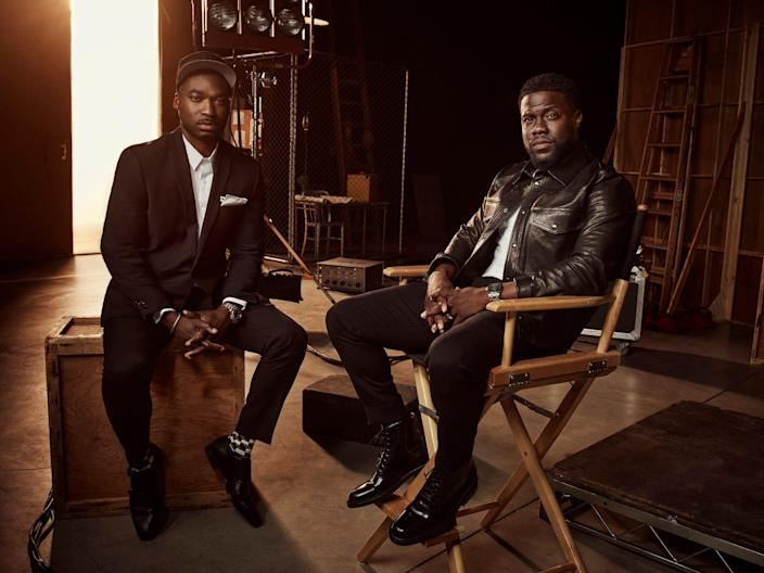 Bryan Smiley and Kevin Hart sitting in director's chairs