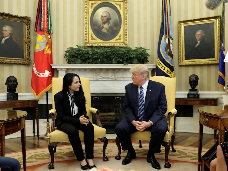 Aya Hijazi, an Egyptian-American woman detained in Egypt for nearly three years on human trafficking charges, meets with U.S. President Donald Trump in the Oval Office of the White House in Washington, U.S., April 21, 2017. REUTERS/Kevin Lamarque