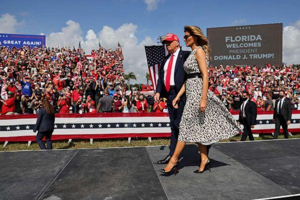 PHOTO: President Donald Trump walks with first lady Melania Trump during his campaign rally outside Raymond James Stadium, in Tampa, Fla., Oct. 29, 2020.  (Jonathan Ernst/Reuters)
