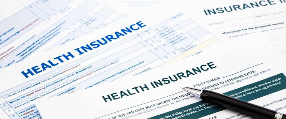 pile of health insurance claim forms
