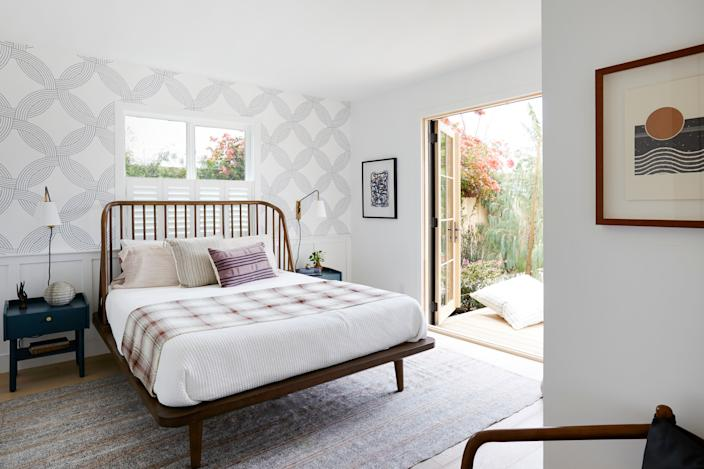 """<div class=""""caption""""> <strong>AFTER:</strong> """"I love how balanced the overall design, look, and vibe is and how it translates so well to our modern farmhouse theme. The home feels complete and the rooms have their own unique personalities, which tie in nicely with the rest of the property,"""" Shanty says of the bedroom. </div>"""