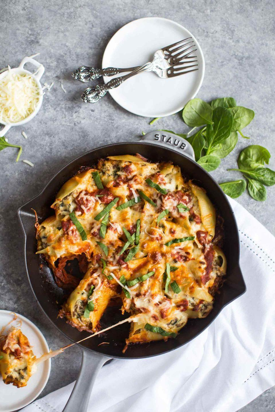 """<p>These pasta shells are stuffed to the brim with a cheesy sausage filling. Top them with even more mozzarella for the ultimate cheese pull. </p><p><strong>Get the recipe at <a href=""""https://www.butterbeready.com/sausage-and-spinach-stuffed-shells/"""" rel=""""nofollow noopener"""" target=""""_blank"""" data-ylk=""""slk:Butter Be Ready"""" class=""""link rapid-noclick-resp"""">Butter Be Ready</a>. </strong></p><p><a class=""""link rapid-noclick-resp"""" href=""""https://go.redirectingat.com?id=74968X1596630&url=https%3A%2F%2Fwww.walmart.com%2Fsearch%2F%3Fquery%3Dcast%2Biron%2Bskillet&sref=https%3A%2F%2Fwww.thepioneerwoman.com%2Ffood-cooking%2Fmeals-menus%2Fg37078352%2Fitalian-sausage-recipes%2F"""" rel=""""nofollow noopener"""" target=""""_blank"""" data-ylk=""""slk:SHOP CAST IRON SKILLETS"""">SHOP CAST IRON SKILLETS</a></p>"""