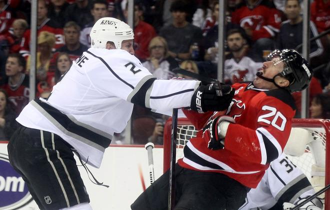 NEWARK, NJ - JUNE 02: Matt Greene #2 of the Los Angeles Kings hits Ryan Carter #20 of the New Jersey Devils during Game Two of the 2012 NHL Stanley Cup Final at the Prudential Center on June 2, 2012 in Newark, New Jersey.  (Photo by Elsa/Getty Images)