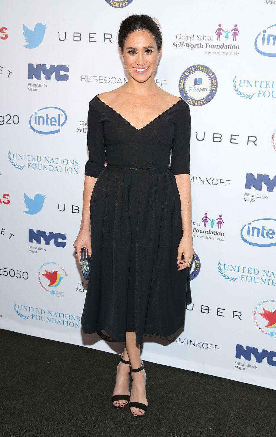 <p>Meghan put a different twist on the classic, opting for an open neckline for an event in NYC in 2015. </p>