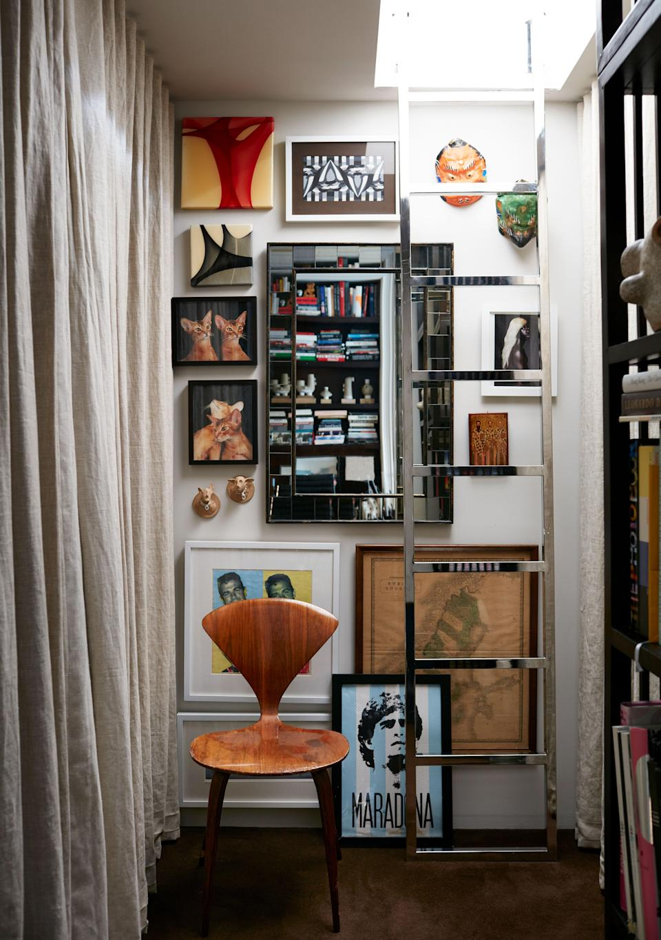A large walk-in closet features storage and a washer-dryer plus a custom-designed cast-metal ladder that leads up to the small guest bedroom upstairs. The poster of Argentinean soccer icon Maradona was salvaged from the street in New York.