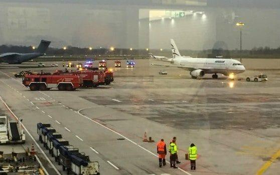 Emergency services on the tarmac at Hannover airport, after a car drove onto the runway