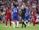 Chelsea's Reece James is shown a red card by referee Anthony Taylor during the English Premier League soccer match between Liverpool and Chelsea at Anfield, Liverpool, England, Saturday, Aug. 28, 2021. (Mike Egerton/PA via AP)