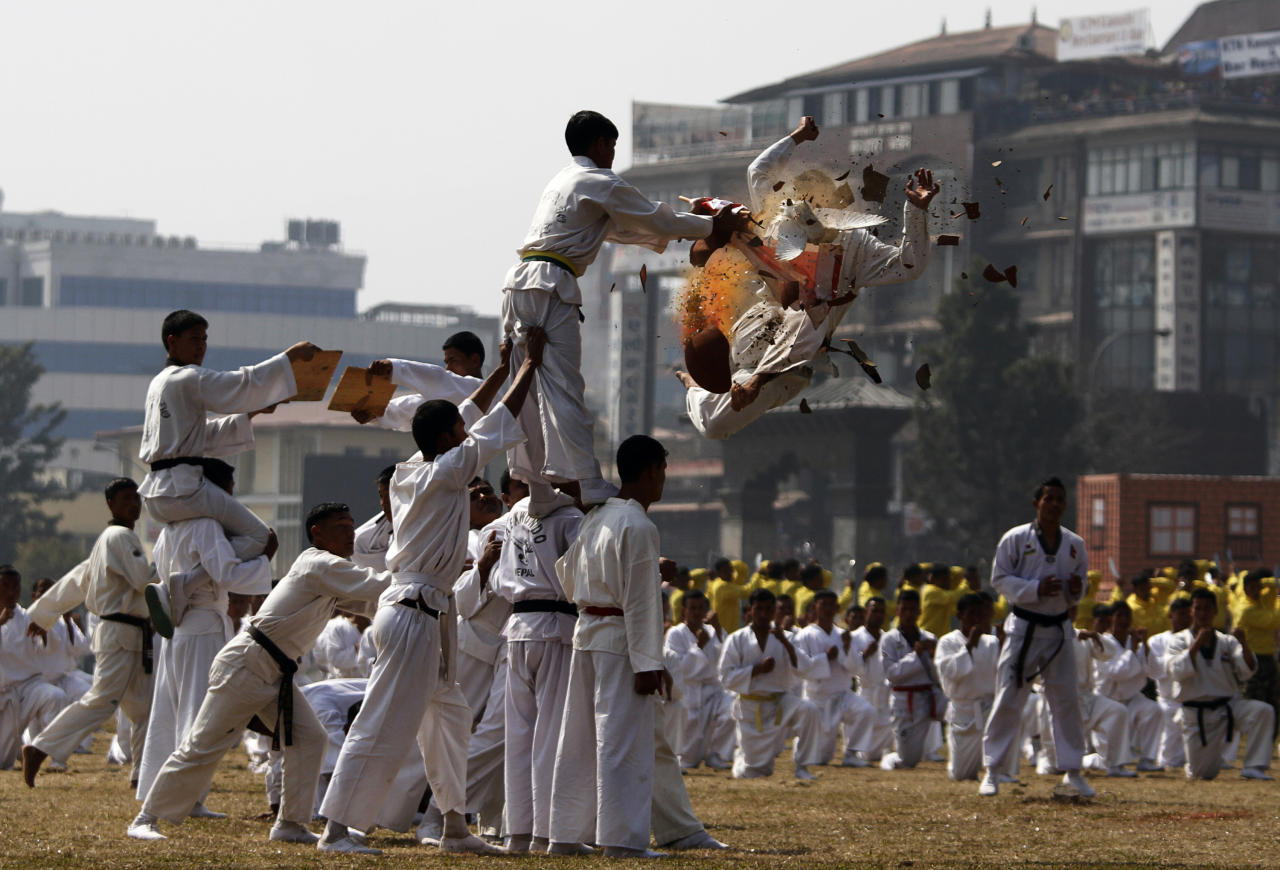 Students of Nepalese army school perform martial arts during Army Day in Katmandu, Nepal, Monday, Feb. 20, 2012. Nepal's Army Day is celebrated annually on Mahashivratri, a festival dedicated to Hindu God Shiva. (AP Photo/Niranjan Shrestha)
