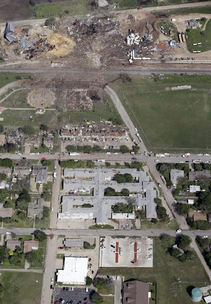 "This April 18, 2013, aerial photo shows a destroyed West Fertilizer Co. plant, top, following an explosion in West, Texas. The Federal Emergency Management Agency is refusing to provide money to help rebuild West, the small Texas town where a deadly fertilizer plant explosion leveled numerous homes and a school, and killed 15 people. According to a letter obtained by The Associated Press, FEMA said it reviewed the state's appeal to help West but decided that the explosion ""is not of the severity and magnitude that warrants a major disaster declaration."" FEMA has, however, provided emergency funds to individual residents. (AP Photo/Tony Gutierrez)"