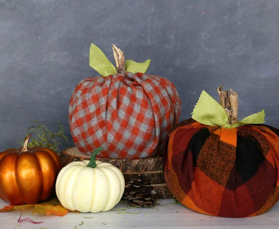 "<p>Toilet paper will never be boring again, because all you have to do is wrap it up with some flannel fabric for a <a href=""https://www.itsalwaysautumn.com/how-to-make-cute-plaid-pumpkins-using-toilet-paper-rolls.html"" rel=""nofollow noopener"" target=""_blank"" data-ylk=""slk:cozy pumpkin decoration"" class=""link rapid-noclick-resp"">cozy pumpkin decoration</a>. Depending what color fabric you use, these can be festive all winter long, too. No one needs to know what's really inside if you don't tell them!</p><p><a class=""link rapid-noclick-resp"" href=""https://go.redirectingat.com?id=74968X1596630&url=https%3A%2F%2Fwww.michaels.com%2Fflannel-print-cotton-fabric-bundle-by-loops-and-threads%2F10631318.html&sref=https%3A%2F%2Fwww.delish.com%2Fholiday-recipes%2Fthanksgiving%2Fg33808794%2Fthanksgiving-decorations%2F"" rel=""nofollow noopener"" target=""_blank"" data-ylk=""slk:BUY NOW"">BUY NOW</a> <em><strong>Flannel fabric, $12.99</strong></em><br></p>"