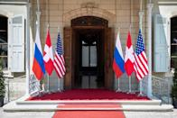 Flags of the U.S., Russia and Switzerland are pictured in front of the entrance of villa La Grange, one day prior to the meeting of U.S. President Joe Biden and Russian President Vladimir Putin in Geneva